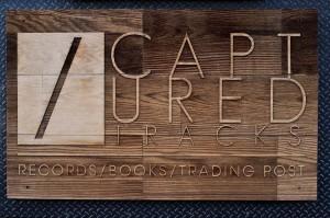 Laser-cut wood sign over diamondplate