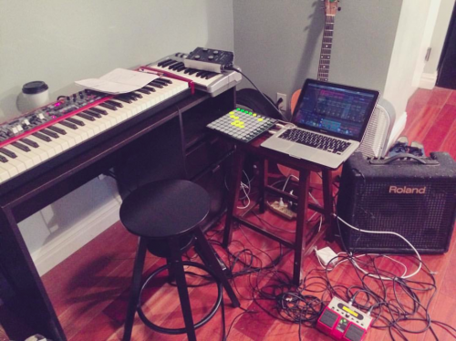 """Courtesy of Half Waif's Facebook page. """"White Prism & I are getting prepped for our set at The Hum: Mondays in October at Manhattan Inn! All the essentials: Ableton, #launchpad, Nord Keyboards, Roland, #bossve20, and of course, coffee."""""""