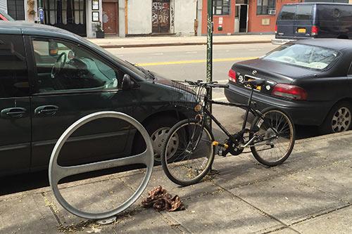 nused hoop rack on Manhattan Avenue - Greenpoint
