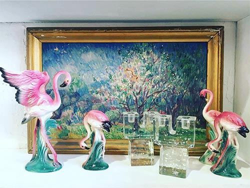 Flamingos, impressionist painting and candlesticks