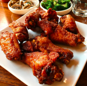 Korean fried chicken wings from instagram @Little Dokebi repost from @nycbbq