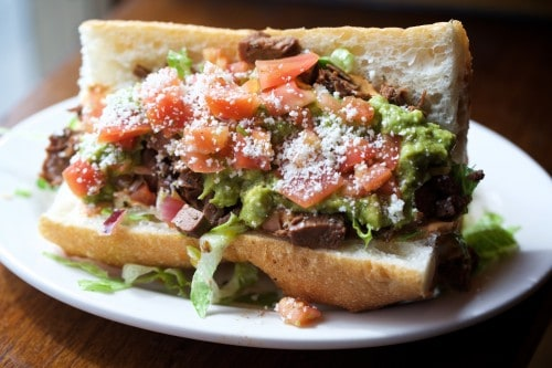 BROOKLYN, NY - April, 1 2016: New spring additions to the menu at Toro Ironworks in Greenpoint. CREDIT: Clay Williams. © Clay Williams / claywilliamsphoto.com BROOKLYN, NY - April, 1 2016: The Mexico City, a carne asada-filled sandwich, one of the new spring additions to the menu at Toro Ironworks in Greenpoint. CREDIT: Clay Williams. © Clay Williams / claywilliamsphoto.com