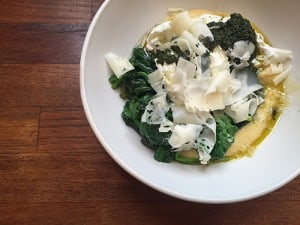 Poached eggs with polenta, charmoula, braised spinach.