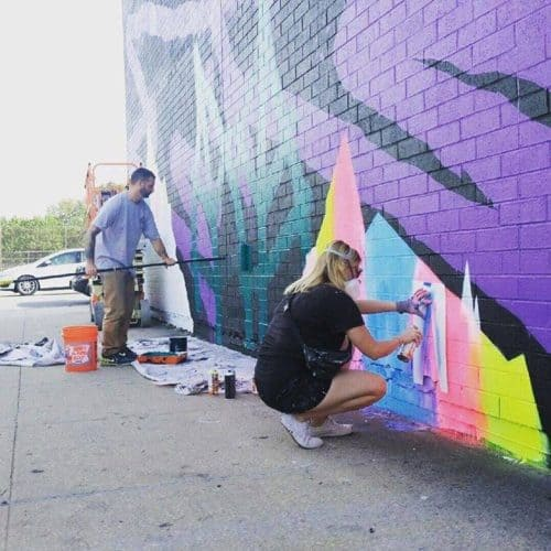 Askew One and Yvette Vexta working on their mural on Berry Street for The Greenest Point