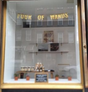 Four of Wands Wellness Collective Williamsburg Store Window