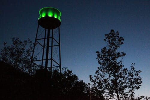The Water Tower illuminates Franklin and Milton in Green Light