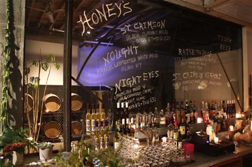 Behind the bar at Honey's. Photo via Honey's.