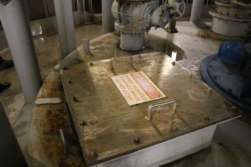 Warning signage inside the Newtown Creek Wastewater Treatment Plant. Photo: Megan Penmann