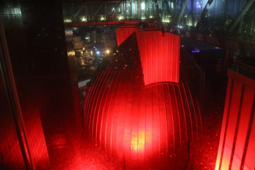 Looking out a rainy window at one of the digester eggs' catwalks. The digester eggs were lit up red for Valentine's Day 2018. Photo: Megan Penmann