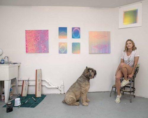 Kate McQuillen and her dog Kassie in her Greenpoint garage studio. Photo: Ian Hartsoe