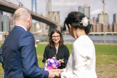 Grace Steite officiating a wedding in Dumbo.